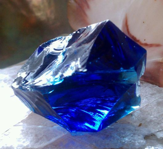 "Starlight Sapphire From cobalt to light blue, is a conduit of the pure ""Blue Ray"". Emanating from the core of the universe, its vibration is the holographic stream of the now, limitless as are we. Restores grace, balance, peace and harmony. It holds the mother energy and is a channel for divine energy."